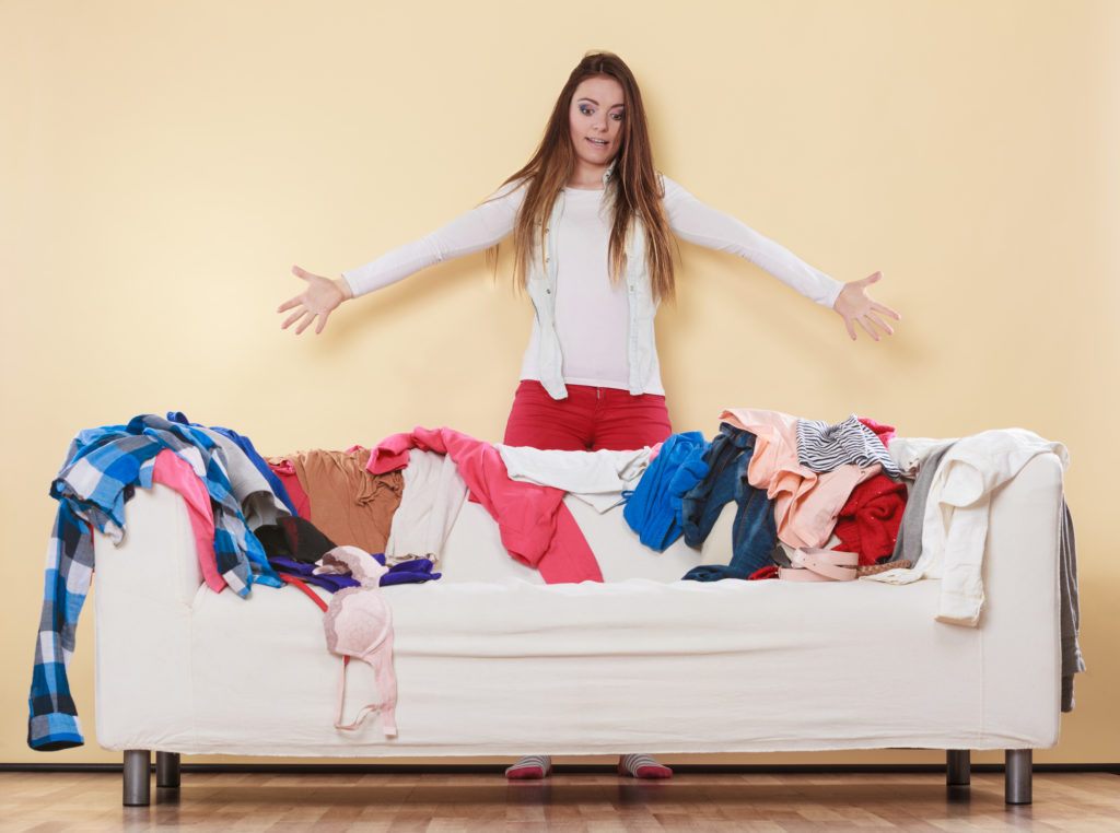 woman with mess of clothes